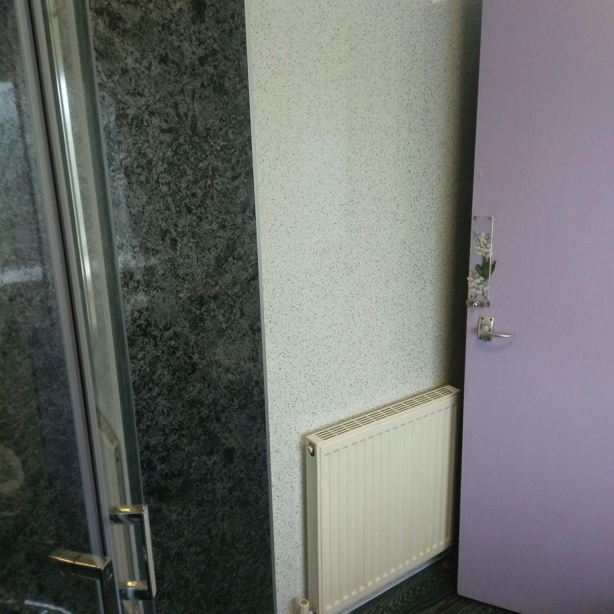 Wet wall bathroom fitting